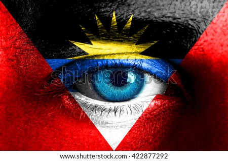Human face painted with flag of Antigua and Barbuda