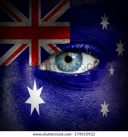 Human face painted with flag of Australia - stock photo