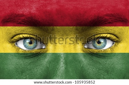 Human face painted with flag of Bolivia