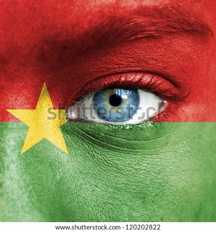 Human face painted with flag of Burkina Faso