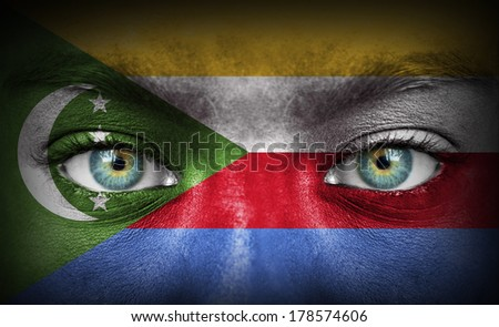 Human face painted with flag of Comoros