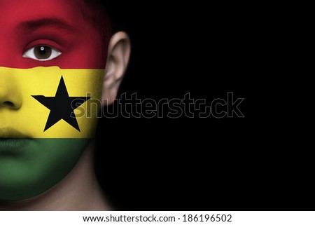 Human face painted with flag of Ghana