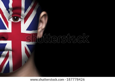 Human face painted with flag of Great Britain - stock photo