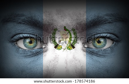 Human face painted with flag of Guatemala - stock photo