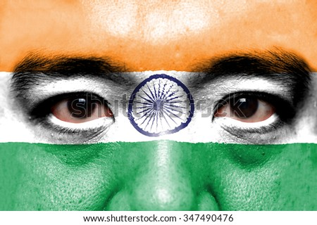 Human face painted with flag of India. - stock photo