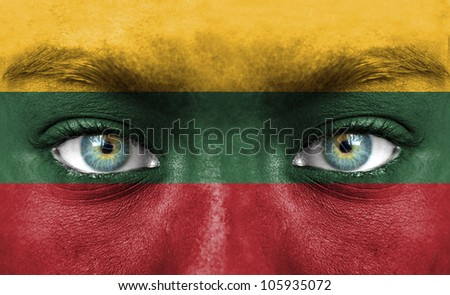Human face painted with flag of Lithuania