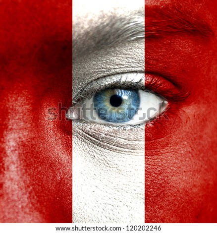 Human face painted with flag of Peru - stock photo