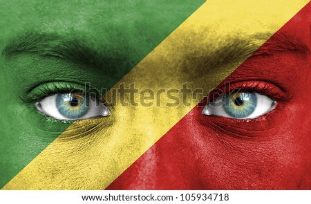Human face painted with flag of Republic of the Congo