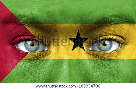 Human face painted with flag of Sao Tome and Principe