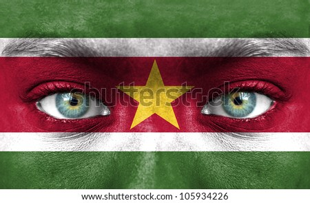 Human face painted with flag of Suriname
