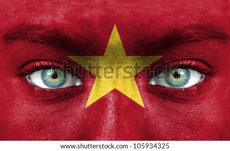 Human face painted with flag of Vietnam