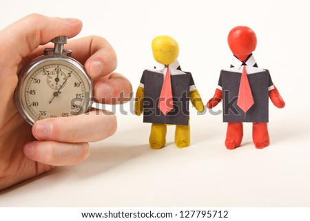 Human figures from clay stand. Business scene. - stock photo