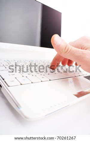 Human finger on a laptop keyboard. Typing - stock photo