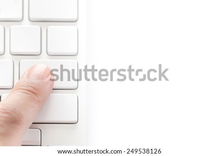 human finger pressing on white keyboard isolated on white background - stock photo