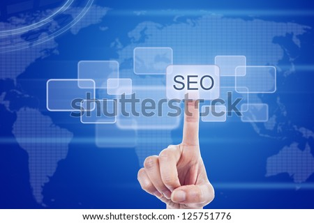 Human finger pressing SEO button touch screen over blue world map background