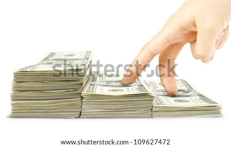Human fingers go up the stairs dollars - stock photo