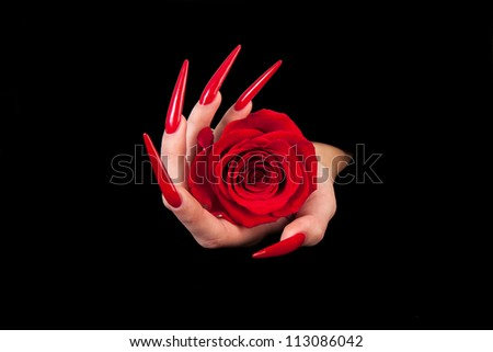 Human fingers with long fingernail and beautiful manicure isolated on black - stock photo