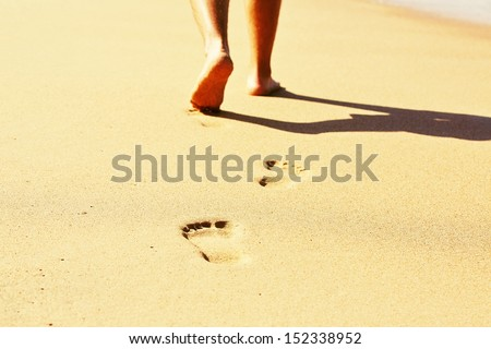 Human footprint in wet sand on the beach - selective focus - stock photo