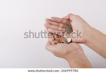 Human hand and coin isolated on a white background - stock photo