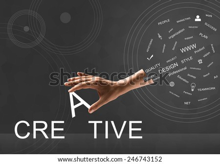 Human hand connecting letters of word creative - stock photo