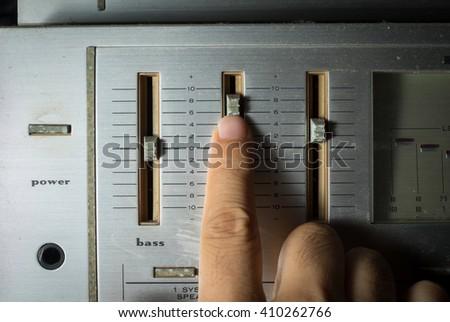 Human hand controlling radio sound - stock photo