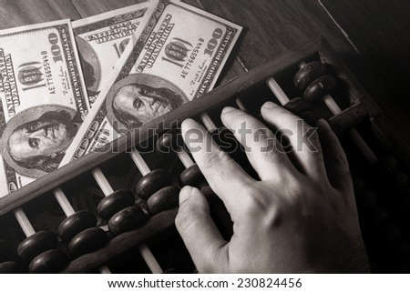 Human hand counting with abacus,black and white color. - stock photo