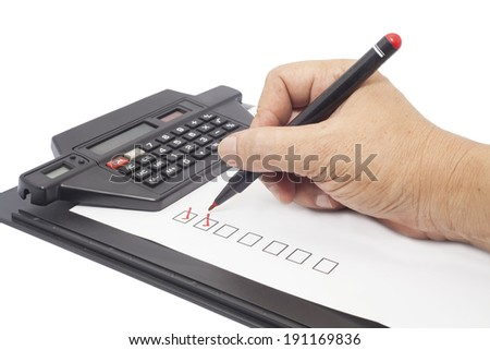 human hand drawing red check mark in checklist box - stock photo