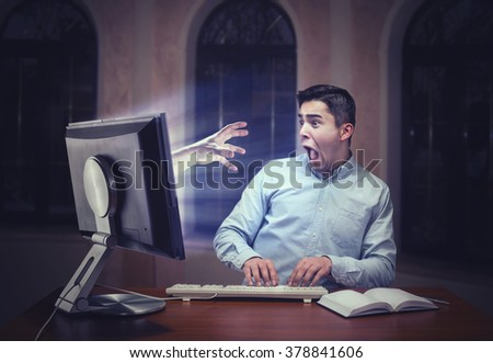 Human hand from the screen - stock photo