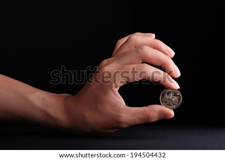 Human hand has a coin
