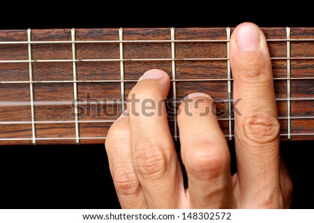 Human Hand Holding Chord On Guitar Stock Photo (Royalty Free ...