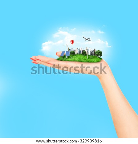 human hand holding a city - stock photo