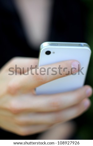 Human Hand Holding a Modern Phone (Businesswoman On the Phone) - stock photo