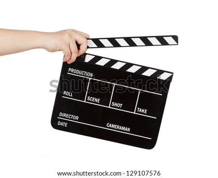 human hand holding a movie clapboard - stock photo