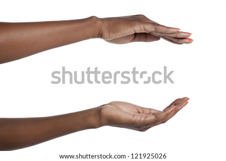 Human hand holding an invisible object over a white background
