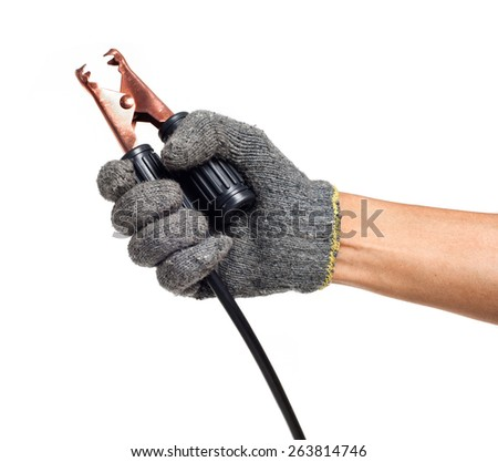 human hand holding black jumper cable for car battery - stock photo