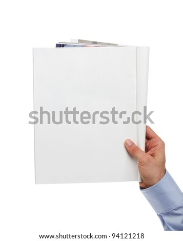 Human hand holding blank magazine with copy space - stock photo