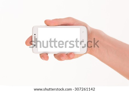 Human hand holding blank mobile smart phone isolated over white background. Turned mobile phone represented in man's right hand.