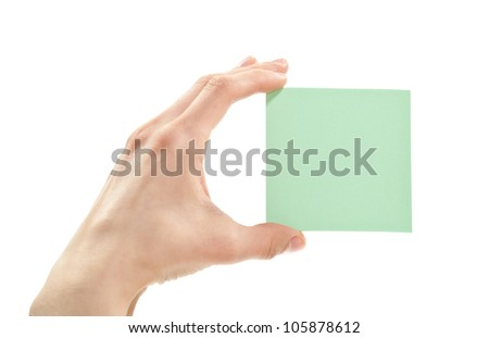Human hand holding blank sticker/note/paper isolated on white - stock photo