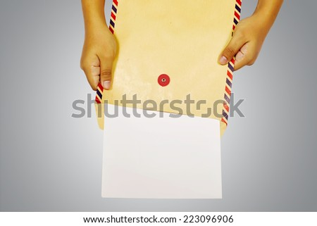 Human hand holding brown envelope. You can put your design here - stock photo