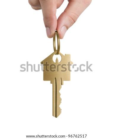 Human hand holding key to a dream house isolated on white - stock photo