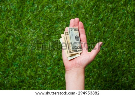 Human hand holding money