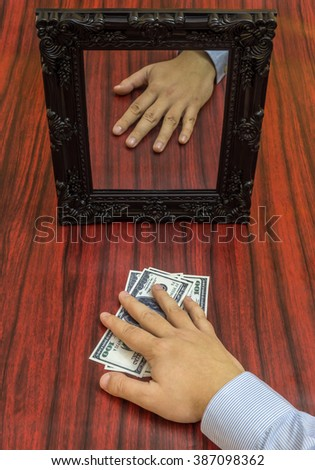 Human hand holding money without reflection in the mirror.