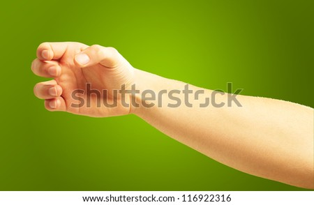 Human Hand Holding On Green Background - stock photo