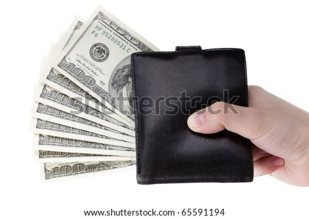 Human hand holding paper dollar currency in wallet - stock photo