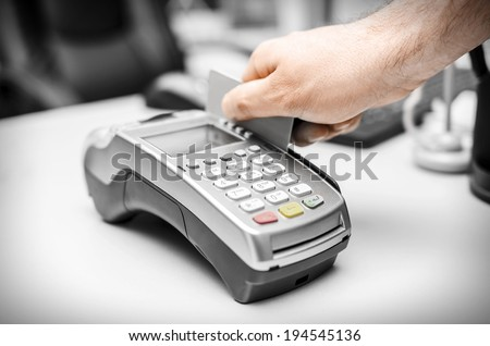 Human hand holding plastic card  - stock photo