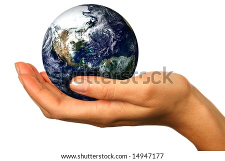 Human Hand Holding the World in Her Hands - stock photo