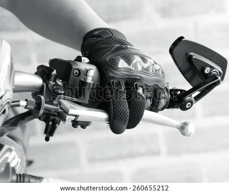 Human hand in a Motorcycle Racing Gloves Ready to ride - stock photo