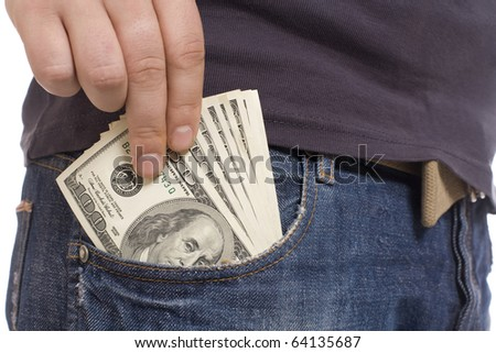 human hand is putting money in the pocket