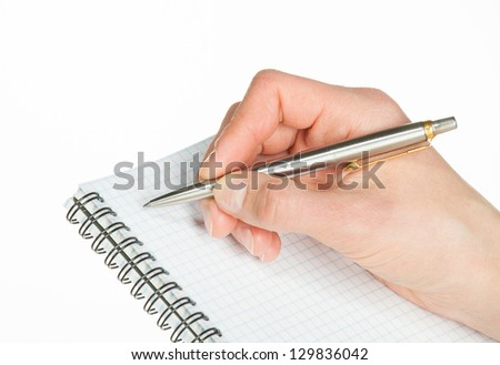 Human hand making notes on the paper on white background