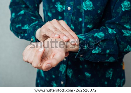 human hand measuring arm pulse - stock photo